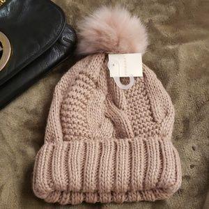 Cable knit pom pom winter cap.